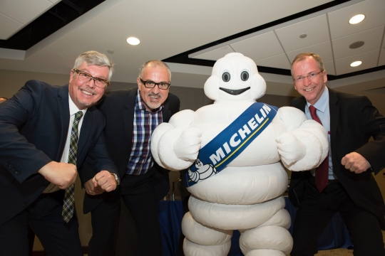 Michelin Challenge Design Jury Members with the Michelin Man
